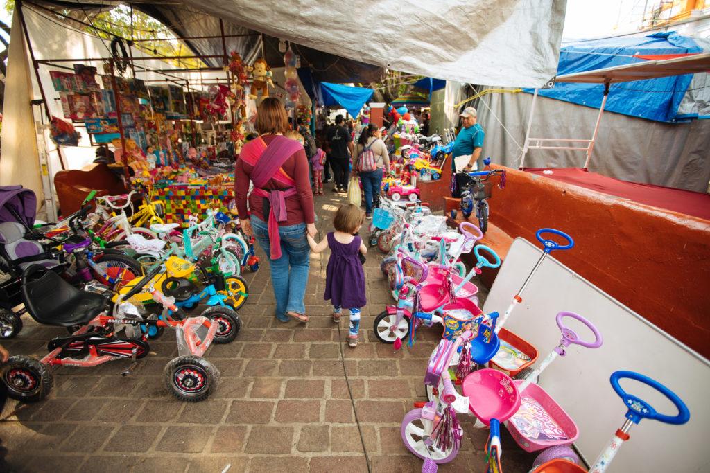 Dreiräder und Gefährte am zócalo